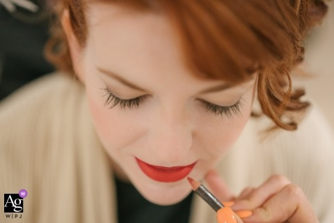 London artistic creative photography detail of bride applying lipstick