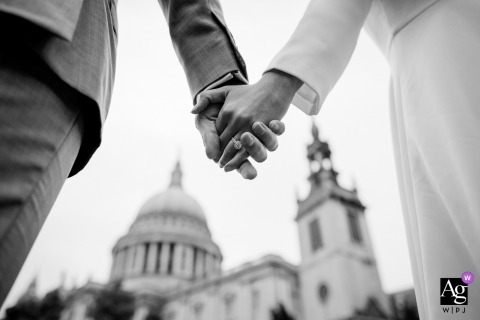 Beijing photographer artistic wedding photo detail of bride and groom hands with church