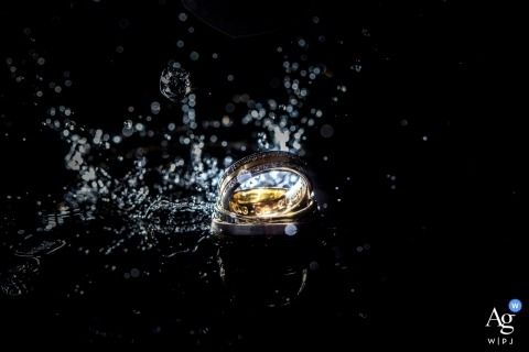 Noord Holland artistic wedding photography details | wedding rings splashing in water