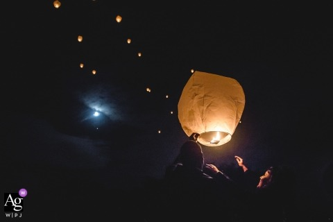 Paris creative wedding photography | detail of paper lantern being released at reception at night