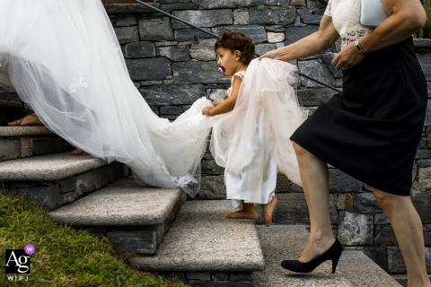 Locarno, Switzerland wedding details | locarno wedding detail photos | bridal dress going up stairs | dress with flowergirl