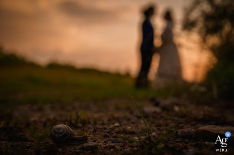 Wedding photograph from Sofia, Bulgaria | Snail Detail with bride and groom at sunset | Slow and gently....