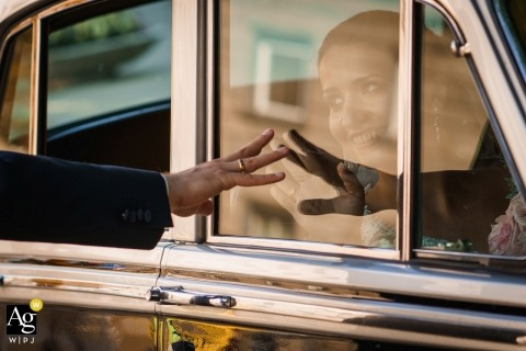 Sofia, Bulgaria wedding photograph | capturing wedding details of bride and groom with car glass reflection