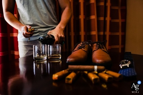 Wedding photography for Westlake Village, Ca | groom with shoes, Whiskey and Cigars