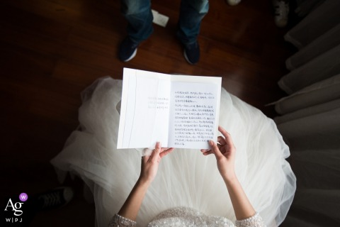 Reading love letters in Sanming hotel room on wedding day