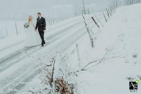 Lyon Auvergne-Rhône-Alpes wedding day portrait of the bride and groom walking in the rural snow.