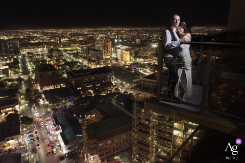 Phoenix, AZ wedding day portrait photographer | City views with the bride and groom on the balcony