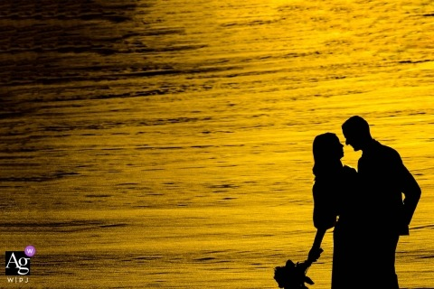 Edmonton, Alberta wedding portrait photography | Silhouette of bride in groom against sunset on water or snow?