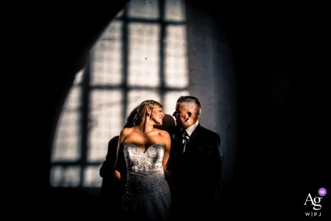 Lucca wedding portrait with the bride and groom and grid shadows from window framing