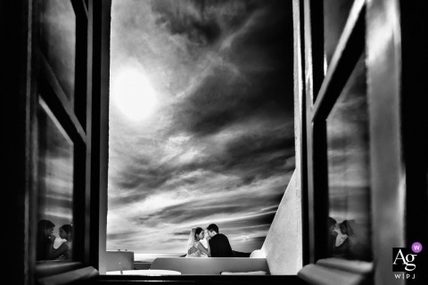 Santorini, Greece wedding day portrait photography | Infinite horizons... Bride and groom captured through open windows