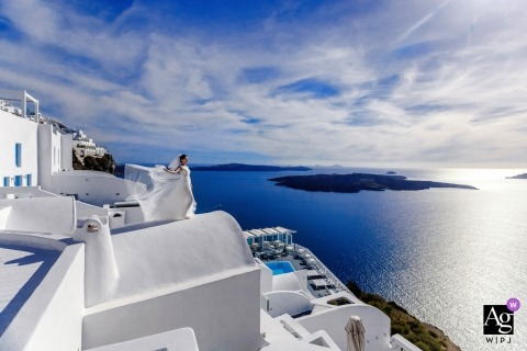 Santorini, Greece wedding photographer | Eternal blue and white landscape portrait of the bride