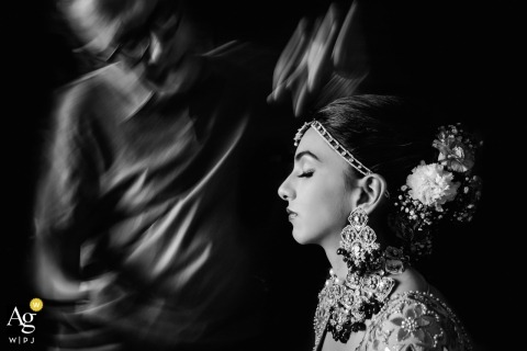 Mumbai, India wedding photographer | Bride getting ready photograph with blurred motion due to a slow shutter speed