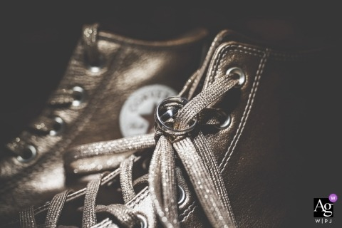 La Spezia wedding photograph detail of rings on chucks Converse hi tops