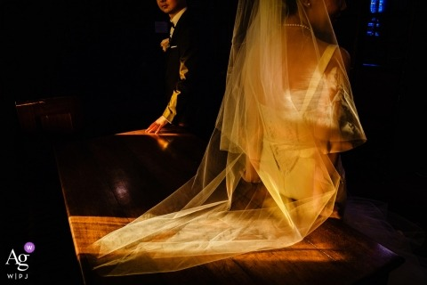 Goddard Chapel, Medford wedding photographer | natural lighting through church window is illuminating the bride and groom