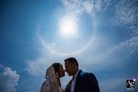 Jetwing Beach Hotel wedding photographer | Post-Ceremony Pictures of the bride and groom with the blue sky and sunshine