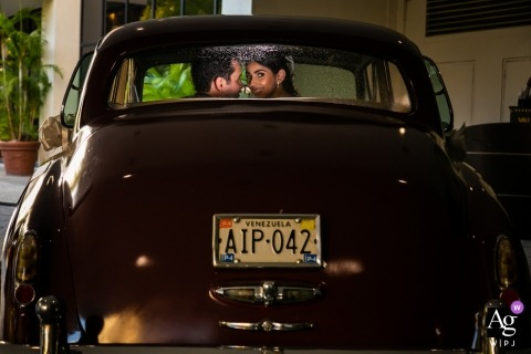Caracas wedding photographer | Looking back through the window of a vintage car in Venezuela