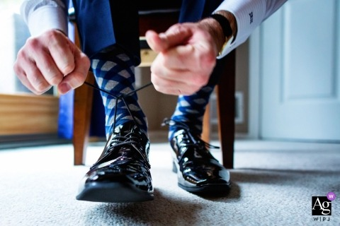 Ryland Inn NJ Weddings | photograph of the groom tying his shoes