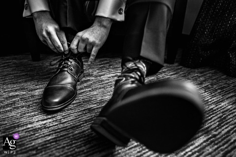 Wedding day photography with the groom putting on his shoes at the Ryland Inn New Jersey Wedding