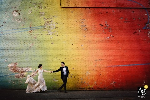 501 Union, Brooklyn, New York wedding photography | Bride & groom portrait walking in front of colorful wall outside