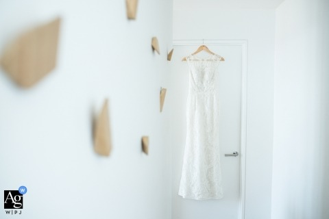 Melbourne wedding photographer | the hanging Wedding dress surrounded in white