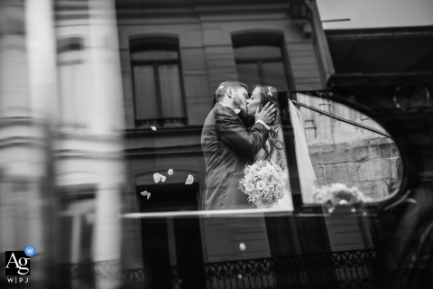 Paris - France wedding photography | a bride and groom Kiss behind the wedding car