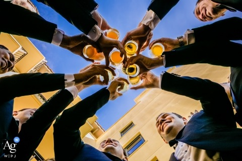 Palos Verdes, California wedding photographer - Groomsmen Cheers, a toast shot from down below