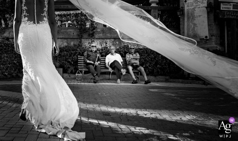 Messina In Piazza ... typical Sicilian wedding - portrait of bride and her dress outside on the streets