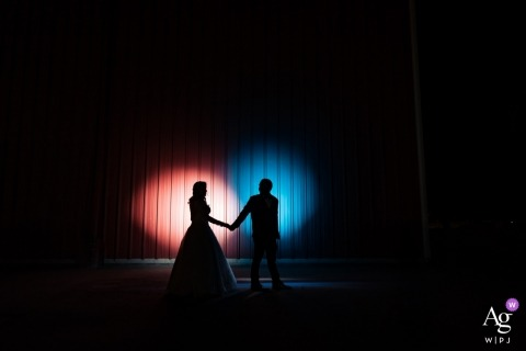Northern California wedding photographer shot the bride and grooms silhouettes as they were lit up by spot lights at their King City reception