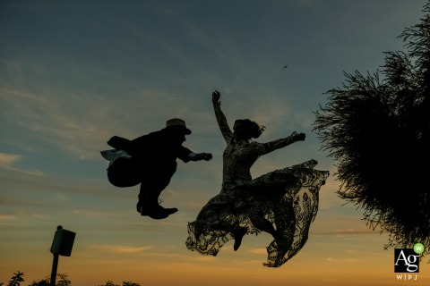 Malibu CA Newlyweds at dusk | Photography of the bride and groom jumping in the air