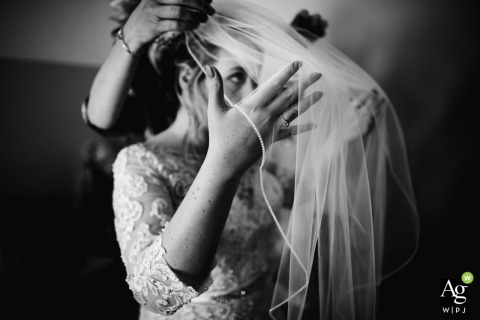 Yelling, Peterborough, United Kingdom	bride adjusting her veil | Wedding Reportage Photography