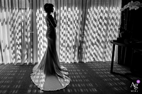 This black and white silhouette shot of the bride standing in front of the windows was captured by a Northern California wedding photographer in San Francisco