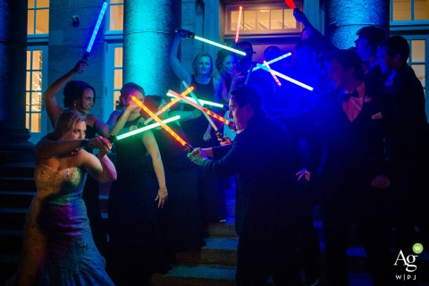 The Ballroom at Ellis Preserve wedding venue photos | Jedi bridal party battling with light sabers at night outside.
