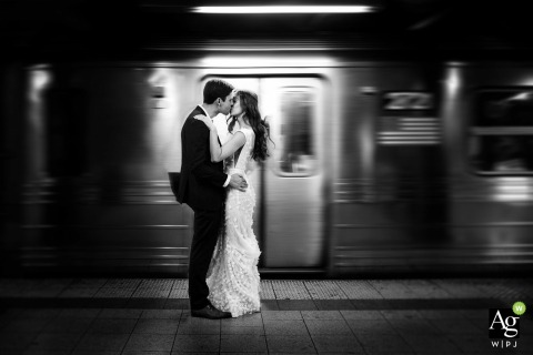 Couple in front of NYC subway | Wedding day portrait photography by the trains in motion with blur
