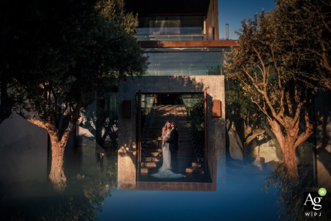 Wedding day portrait of the bride and groom using the Door for light | Areias do Seixo - Portugal wedding venue photography