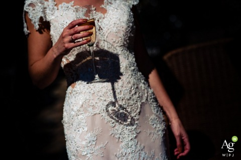 Vlaamse Spijcker Dongen wedding venue photo | Cheers for the bride | Glass, dress, detail, shadows