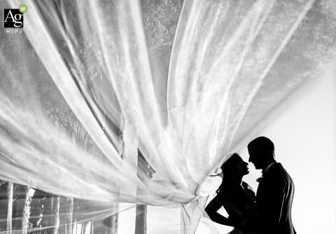 antica fattoria di paterno wedding venue photo - couple in silhouette in black and white