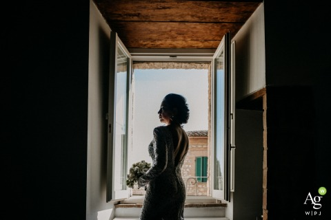 Castello di Montignano Wedding Day Photography | Portrait of the bride alone at the venue
