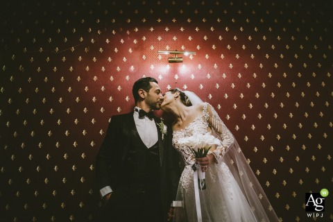 Mersin Martı Hotel Turkey wedding venue photo | Bride and Groom Kissing on a gothic wall