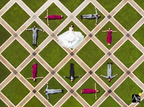 Curzon Hall, Sydney, Drone wedding shot of whole bridal group lying on the special pattern floor.