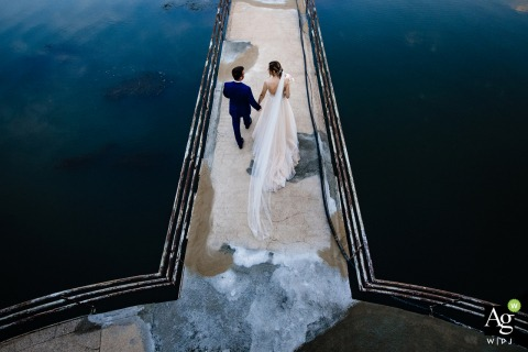 Wedding Photography at the Venue, Restaurant Lebed | Top view of the bride and groom walking on an old bridge