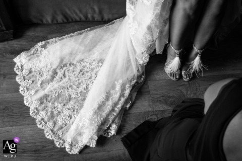 Madrid wedding photographer caught this detail image of the brides feathery shoes and bridal train as she sits and waits for the ceremony to start