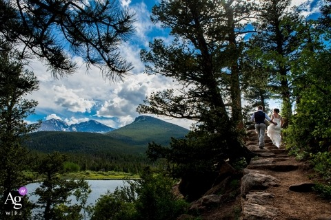 Wedding Photo of the bride and groom hiking at Lily Lake in the Rocky Mountain National Park