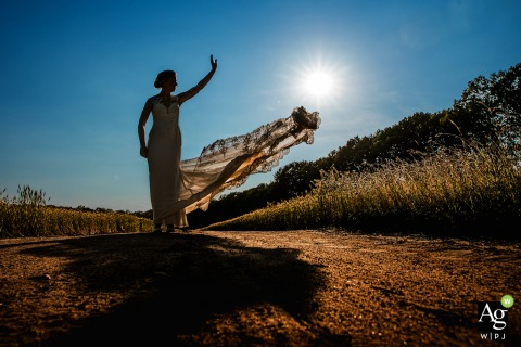 Woeste Hoeve Venue Photography | Bride and her wedding dress in golden hour.