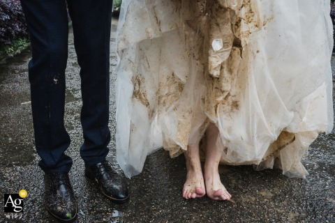 Nanping outdoor park wedding resulted in this detail of the groom and bride with a very muddy dress