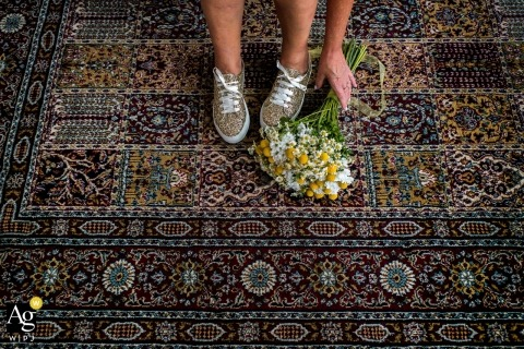 Mannenzaal Amersfoort wedding photo of the bride, after she changed her shoes post-ceremony, picking up her bouquet off the floor