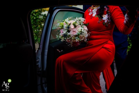 VIETNAM	BRIDE HOUSE WEDDING PHOTO | The detail of Ao Dai dress when bride was steping to car.
