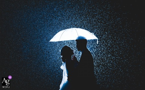 It rained and the bride and groom hugged at the dinner venue