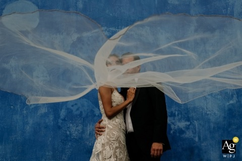 Hotel Azul Wedding Photography | The wind playing in the middle of a bride and groom portrait session