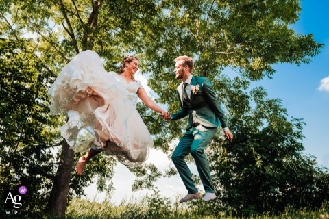 Netherland Wedding Photography - Bride and groom jumping on trampolin