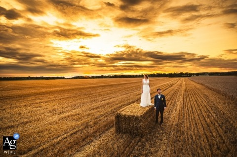 Panonska vas, Moravske Toplice, Slovenia - Bride and groom standing at fresh cut field for Wedding Portraits
